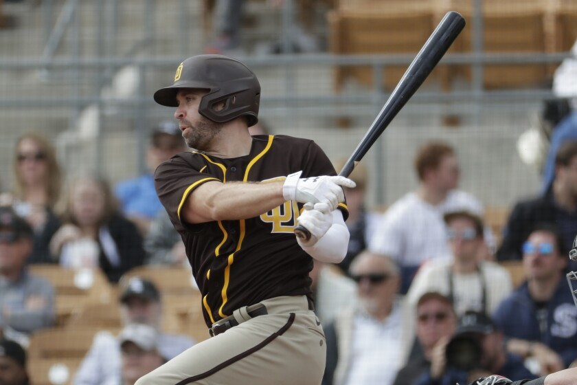 San Diego Padres Brian Dozier against the Chicago White Sox during the first inning of a spring training baseball game Monday, March 2, 2020, in Glendale, Ariz.