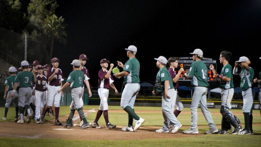 Park View (green uniforms), shown shaking hands after Sunday's late win, dropped a 5-3 decision on Monday to Las Vegas Silverado West.