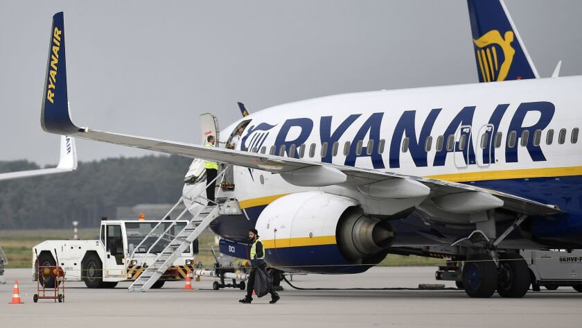 FILE - In this Wednesday, Sept. 12, 2018 file photo, a Ryanair jetplane parks at the airport in Weez