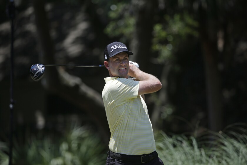 Webb Simpson hits off the second tee during the final round of the RBC Heritage golf tournament.