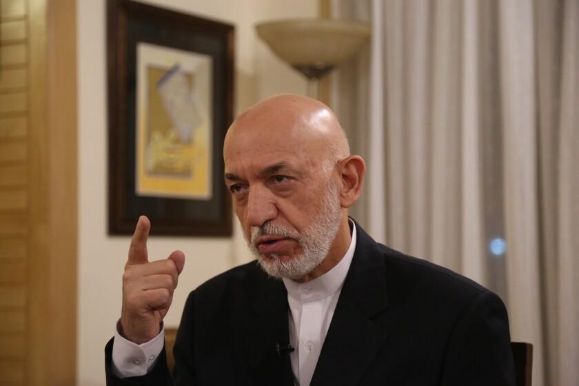 Former President Hamid Karzai speaks during an interview in Kabul, Afghanistan, Tuesday, Sept. 24, 2019. (AP Photo/Rahmat Gul)
