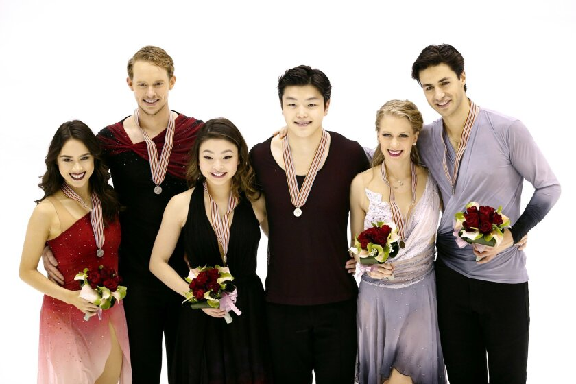 Medal winners Maia Shibutani and Alex Shibutani from the United States with gold, center, Madison Chock and Evan Bates from the United States with silver, left, and Kaitlyn Weaver and Andrew Poje from Canada with bronze, pose together for a photo after competing in the Ice Dance Free Dance program