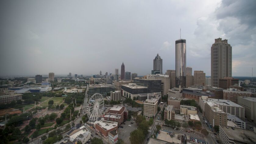 The city skyline is seen has thunderstorms move through, Monday, July 24, 2017, in Atlanta. Thunders
