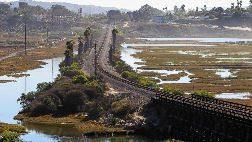 SAN DIEGO, CA November 29th, 2016   The San Elijo Lagoon rail bridge and tracks cross through the Sa