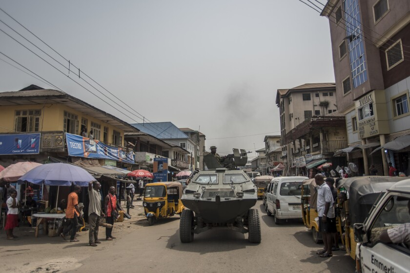A Nigerian army tank moves along a street in a pro-Biafra separatist zone in Aba.