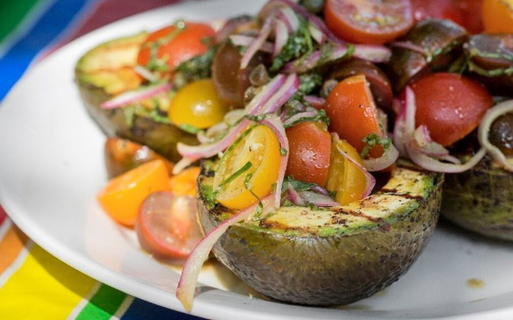 Grilled avocado with marinated tomato salad