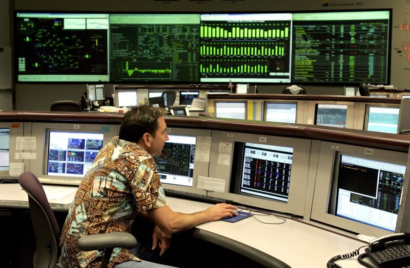 Inside the control room of the California Independent System Operator facility in Folsom.