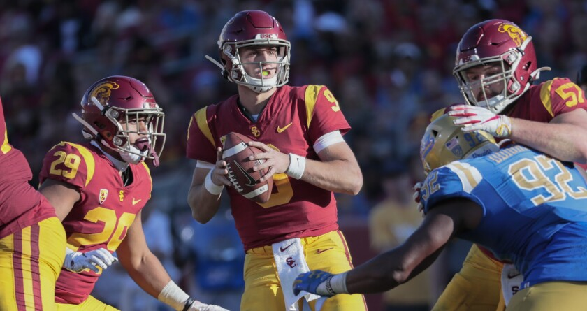 Trojans quarterback Kedon Slovis drops back to pass against the Bruins during their game on Nov. 23, 2019, at the Coliseum.
