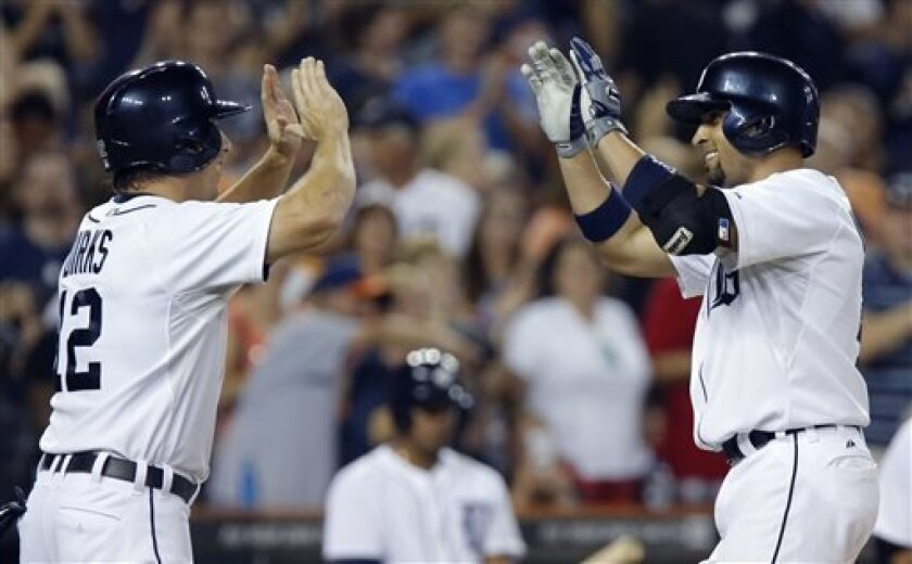 Detroit Tigers' Omar Infante, right, is greeted at home plate by Andy Dirks after hitting a two-run home run in the sixth inning of a baseball game against the Cleveland Indians Saturday, Aug. 31, 2013, in Detroit. (AP Photo/Duane Burleson)