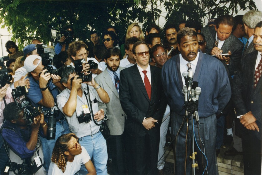 Rodney King speaks to the press on May 1, 1992, making a plea for the rioting to stop.