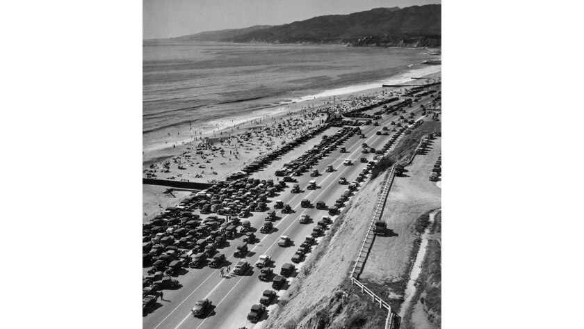 March 1, 1936: On a warm spring day, thousands descended upon Southern California beaches. Cars look for parking on Roosevelt Highway (now Pacific Coast Highway) near mouth of Santa Monica Canyon in Malibu.
