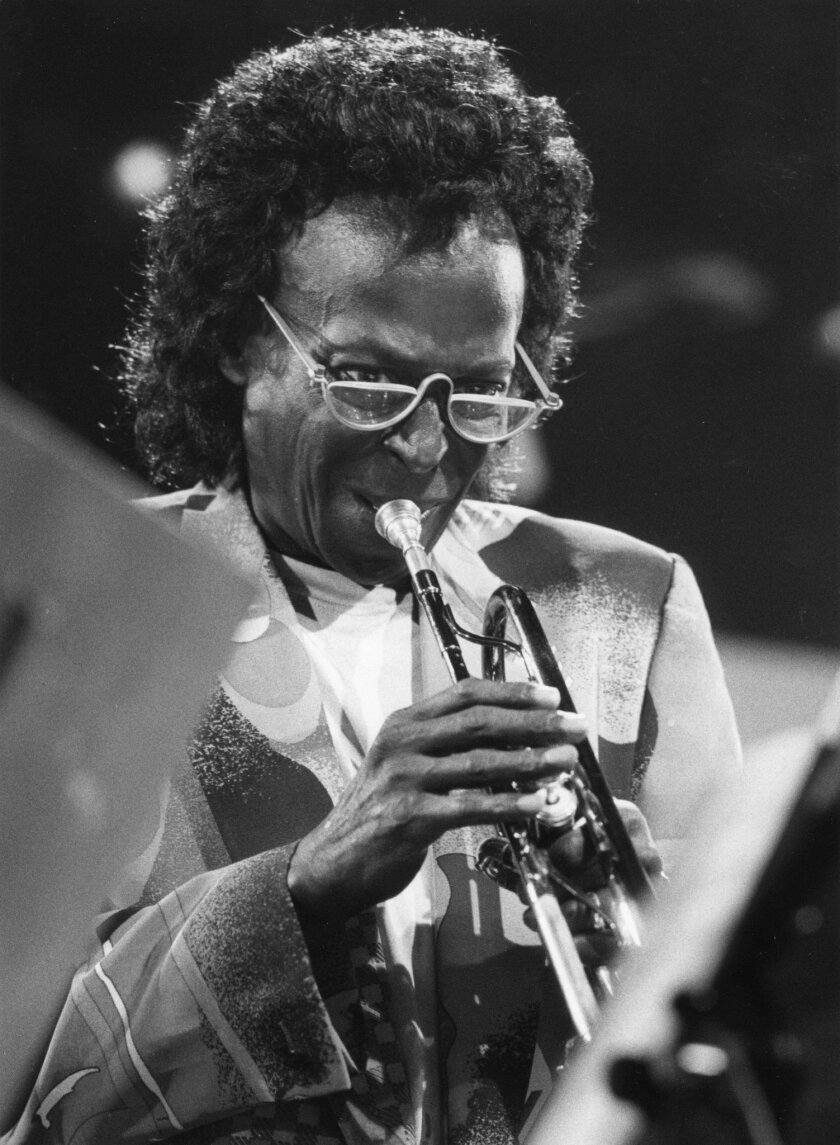 FILE - In this July 8, 1991 file photo, Miles Davis performs at the Jazz-Festival in Montreaux, Switzerland.  Davis appeared for the first time at the Newport Jazz Festival in 1955 and gave a career-reviving performance. This year's program book is Miles-centric as the festival, which begins July 3
