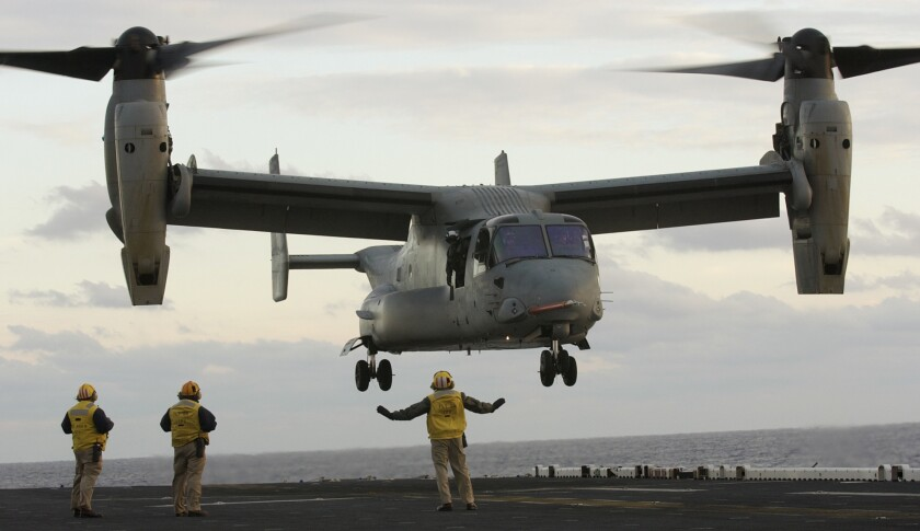 A V-22 Osprey takes off from the deck of the aircraft carrier Iwo Jima off North Carolina in 2003.