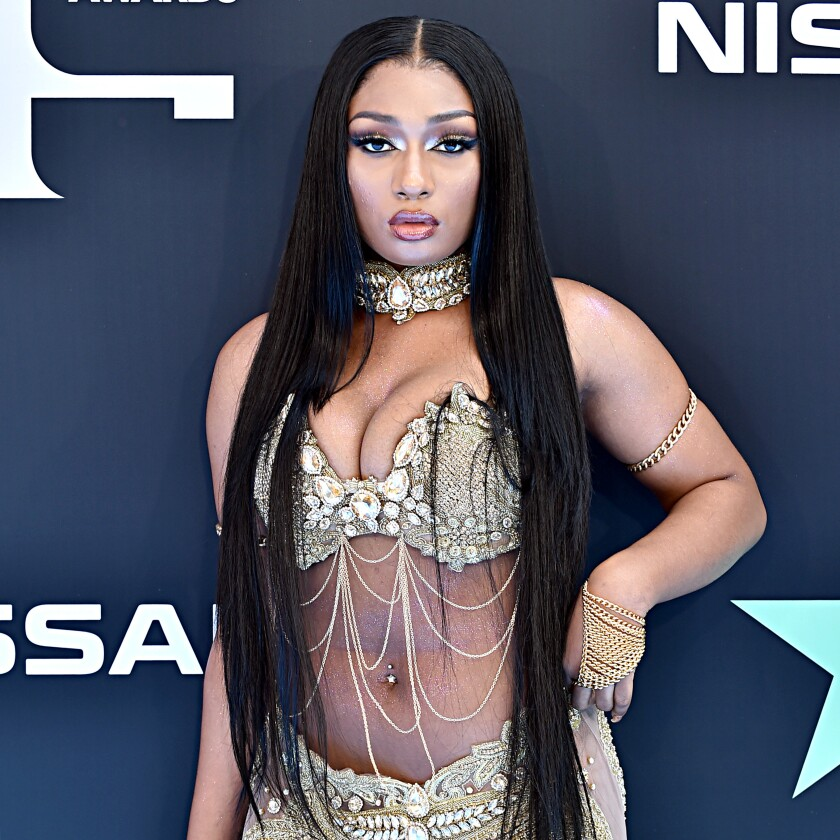 A woman in formal attire