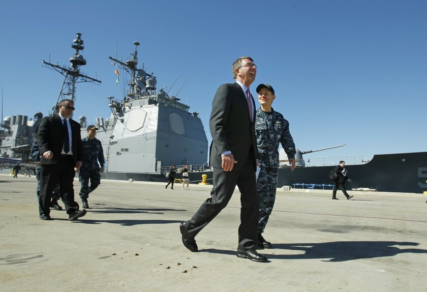 Defense Secretary Ash Carter walks with Vice Adm. Nora Tyson at the San Diego Naval Base after touring the destroyer Spruance and the cruiser Princeton on Wednesday. / photo by K.C. Alfred * U-T