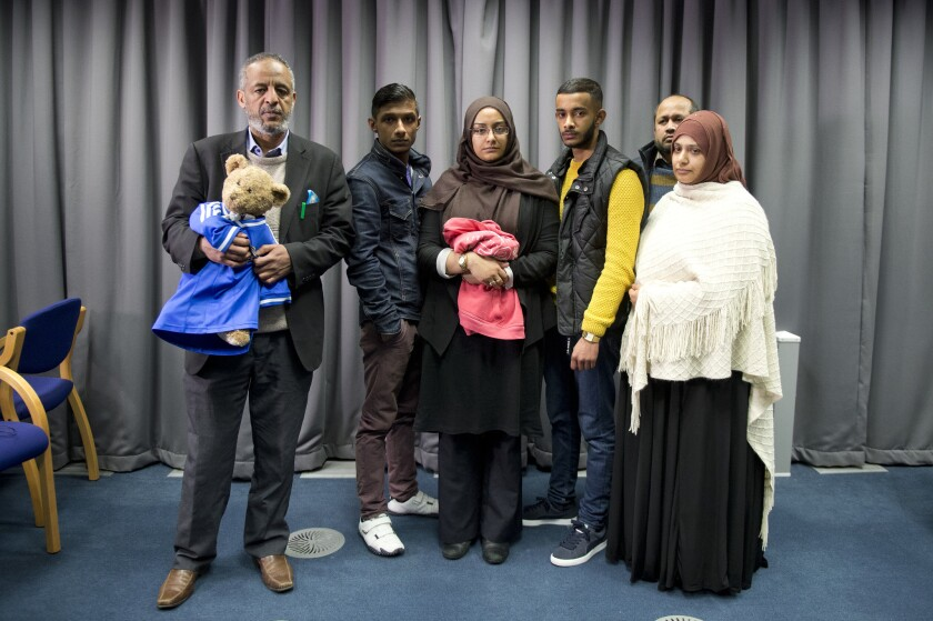 The families of Amira Abase and Shamima Begum, two of the three missing schoolgirls believed to have fled to Syria to join Islamic State, pose after being interviewed by the media at New Scotland Yard in February. The family members pleaded for the girls to return home.