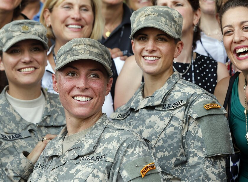 U.S. Army First Lt. Shaye Haver, center, and Capt. Kristen Griest, right, pose for photos with other female West Point alumni after an Army Ranger school graduation ceremony, Friday, Aug. 21, 2015, at Fort Benning, Ga. Haver and Griest became the first female graduates of the Army's rigorous Ranger