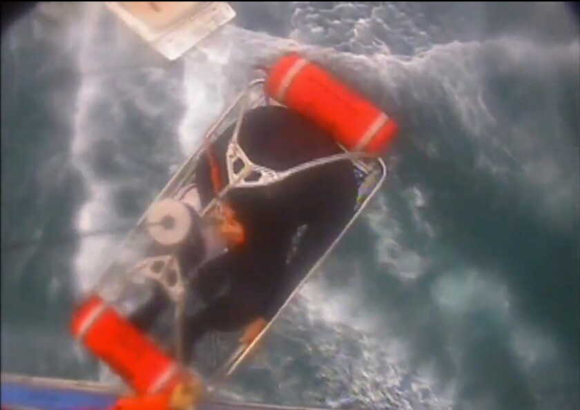 "In this Saturday, Dec. 21, 2019, video image released by the U.S. Coast Guard shows a man, wearing a full-body wetsuit, being hoisted up from the boat into the helicopter near Santa Rosa Island, one of the Channel Islands in Southern California. A shark reportedly bit a surfer Saturday afternoon in a ""truly terrifying situation,"" the Coast Guard said. The 37-year-old man had been surfing near Santa Rosa Island, one of the Channel Islands, during the attack, according to a news release. (U.S. Coast Guard Los Angeles via AP)"