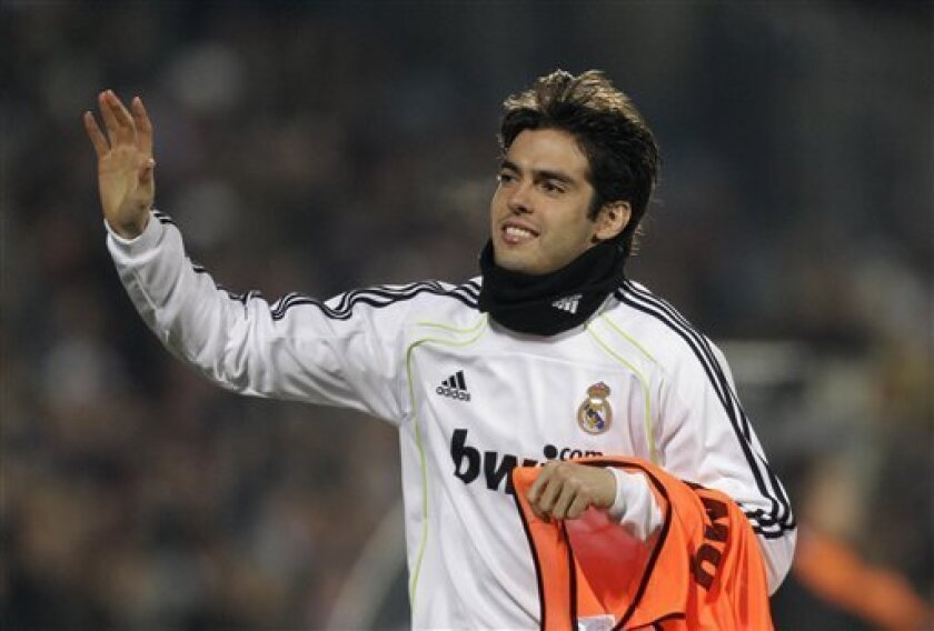 Real Madrid's Kaka from Brazil waves to fans as he warms up as substitute during a Spanish La Liga soccer match against Getafe at the Coliseum Alfonso Perez stadium in Getafe, Spain Monday, Jan. 3, 2011. Kaka has been injured for several months and is back in the team squad.(AP Photo/Paul White)