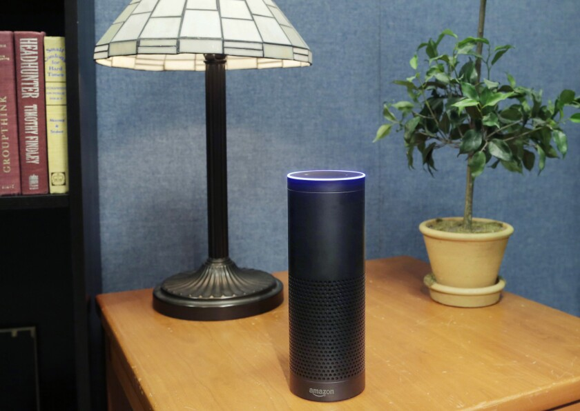This 2015 file photo shows Amazon's Echo -- a device facing big competition from Google this holiday season.