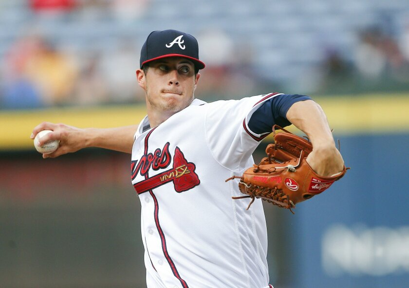 Atlanta Braves starting pitcher Matt Wisler works in the first inning of a baseball game against the Milwaukee Brewers on Thursday, May 26, 2016, in Atlanta. (AP Photo/John Bazemore)
