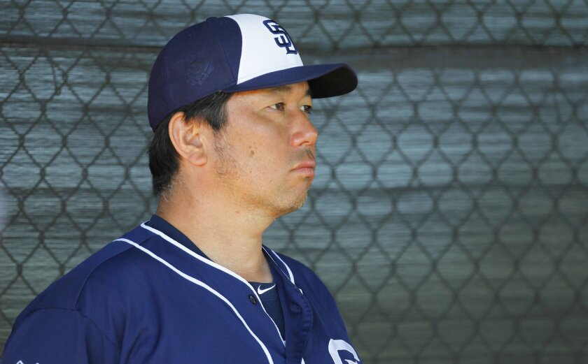 San Diego Padres advisor for baseball operations Hideo Nomo looks on during a practice at spring training.