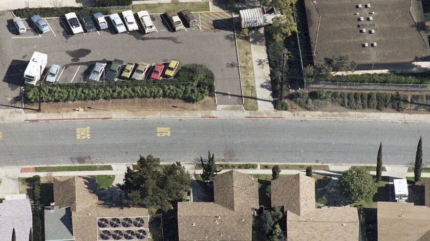 Arial photo showing Brenda Spencer's home facing the school driveway and the trash truck across the school walkway to shield the wounded.