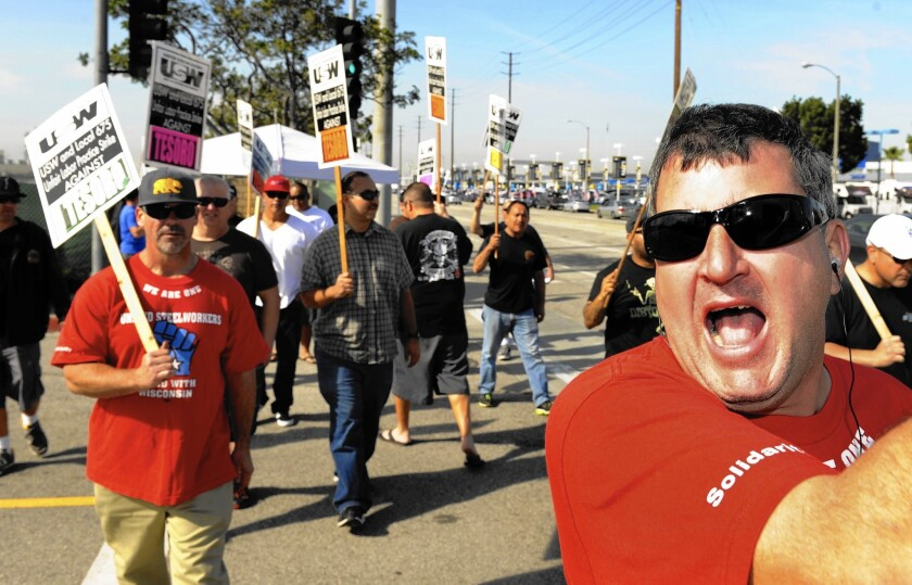 Workers at nine refineries — including Tesoro Corp.'s Carson facility, above — remained on strike for a second day Monday amid a standoff between the United Steelworkers union and oil companies over contract negotiations.