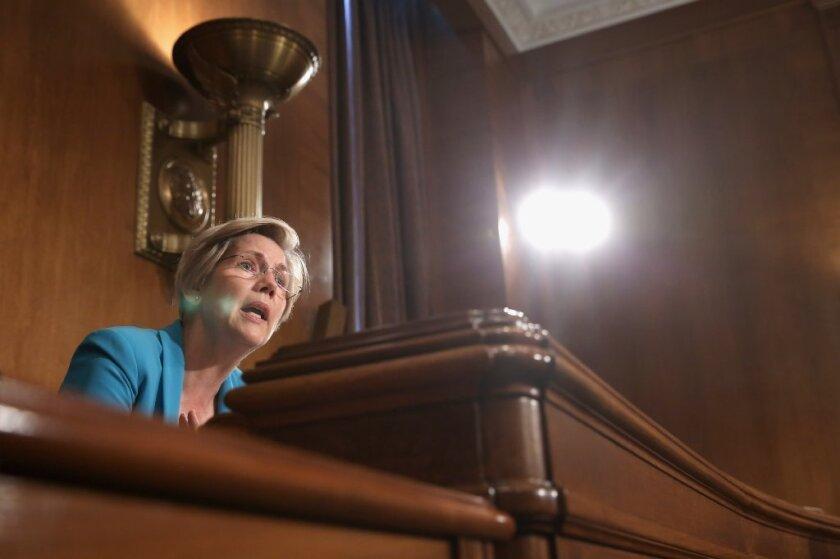 Sen. Elizabeth Warren is aiming her fire at the regulators who gave JPMorgan a pass.