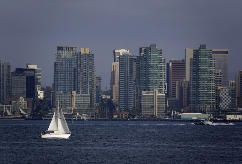 A boat sails in San Diego Bay on Thursday, Dec. 10, 2020 in San Diego, CA.
