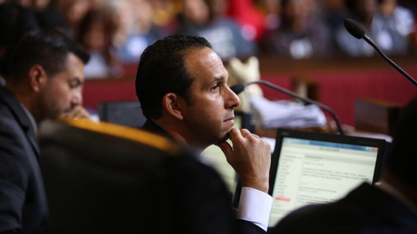 Los Angeles City Councilmember Mitch Englander listens as the council moved to the forefront of a national campaign to boost the incomes of low-wage workers on June 3, 2015.
