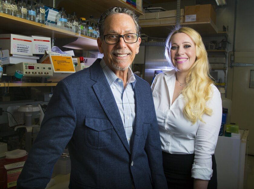 At the Salk Institute for Biological Studies in La Jolla, Ron Evans (left) specializes in conditions related to metabolism and Janelle Ayres focuses on the microbiome, which is the set of all microbes that live in and on a person.