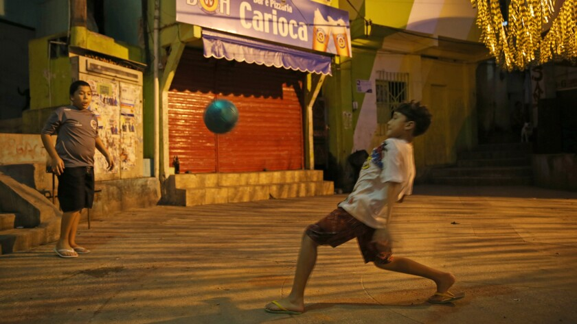 Children play a game of soccer in the streets of a favela in Rio de Janiero on Sunday. Many of Brazil's soccer stars came from humble beginnings where playing barefooted soccer in the streets was a part of life.