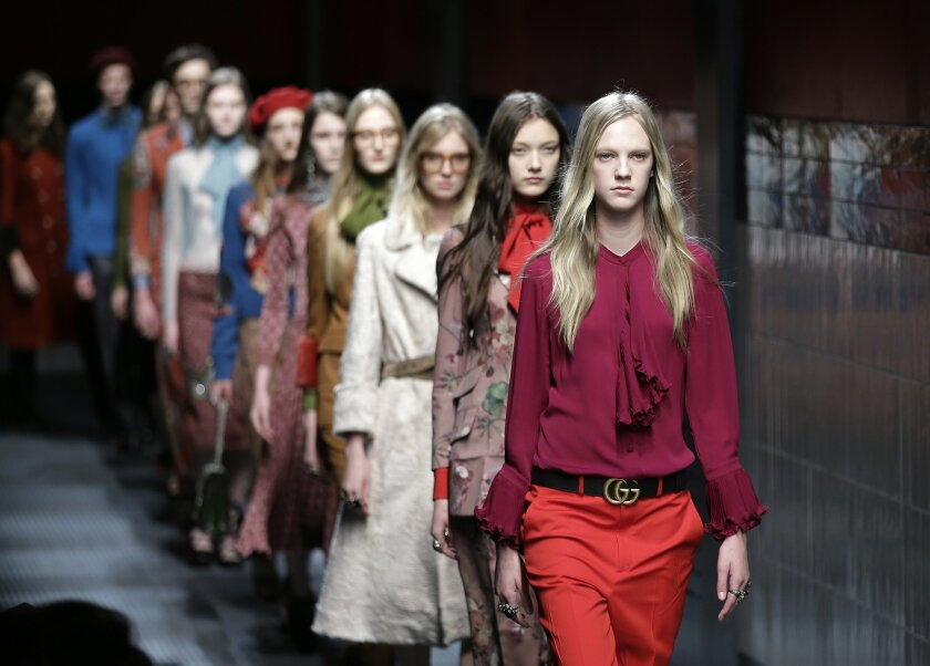 Models wear creations for Gucci women's Fall-Winter 2015-2016 collection, part of the Milan Fashion Week, unveiled in Milan, Italy, Wednesday, Feb. 25, 2015. (AP Photo/Antonio Calanni)