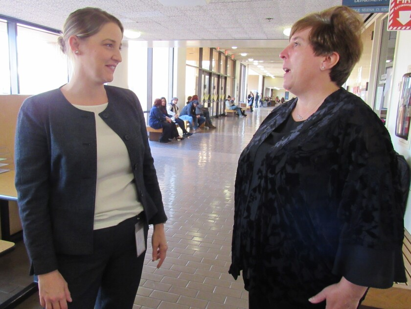 Court-appointed public defender Lesley O'Brien (left) tells Lemon Grove resident Teresa Rosiak on Thursday that the city dropped three misdemeanor charges against Rosiak.