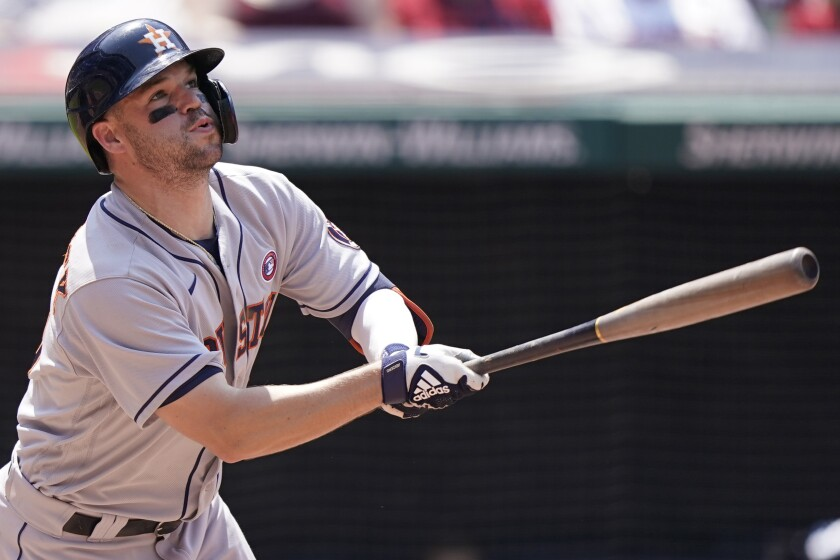 Houston Astros' Chas McCormick watches his two run home run in the sixth inning of a baseball game against the Cleveland Indians, Sunday, July 4, 2021, in Cleveland. (AP Photo/Tony Dejak)