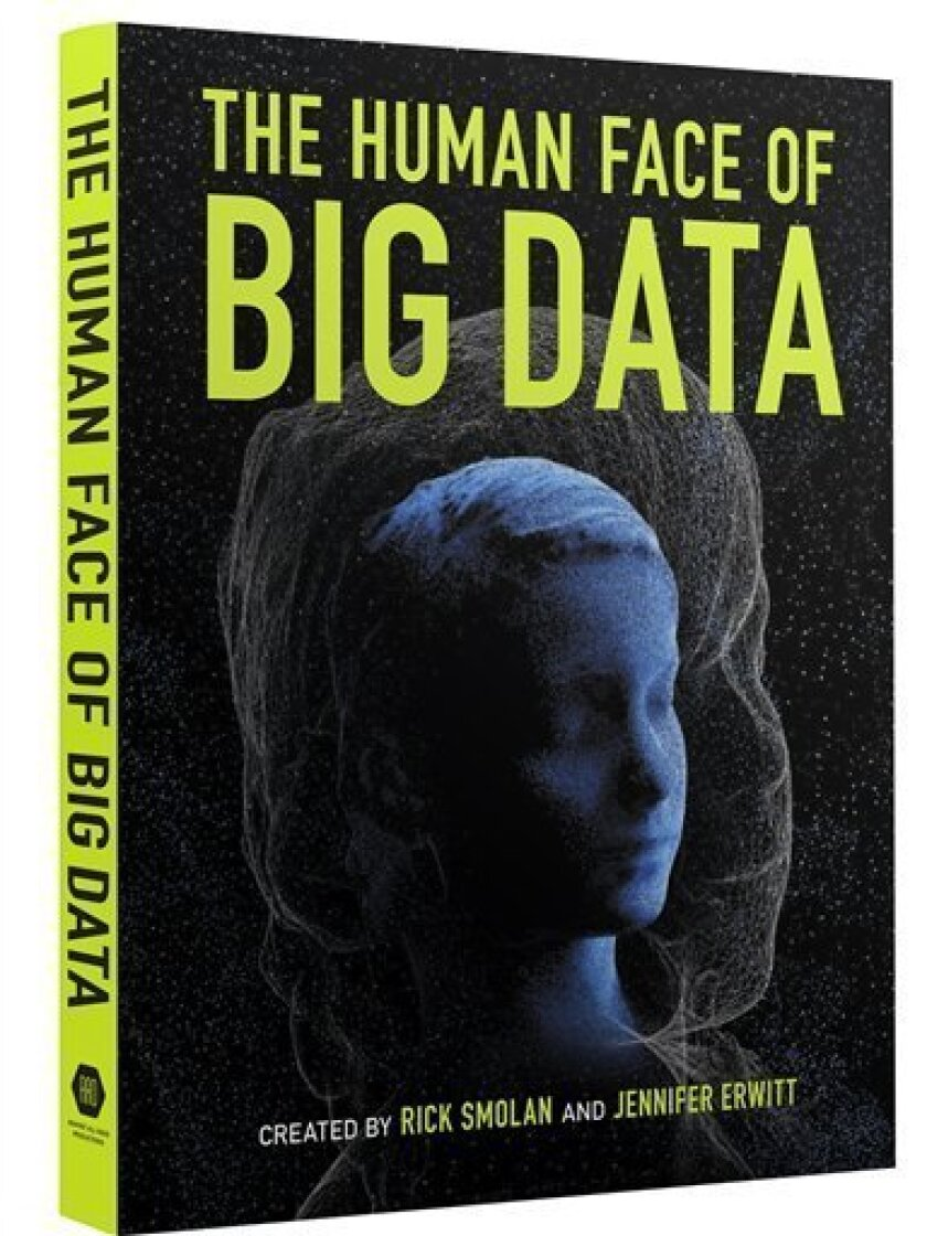 """This book cover image released by Against All Odds Productions shows """"The Human Face of Big Data,"""" by Rick Smolan and Jennifer Erwitt. At nearly five pounds (a companion iPad app is available), it is being delivered Tuesday by the publisher to what it calls some of the world's most influential people, including the CEOs of Yahoo and Starbucks and Amazon, Oprah Winfrey and New York Mayor Michael Bloomberg. The goal, say those behind the project, is to """"ignite a conversation about an extraordinary knowledge revolution."""" (AP Photo/Against All Odds Productions)"""
