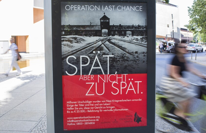 """An Operation Last Chance placard reading """"Late, but not too late"""" is displayed in Berlin on Tuesday."""