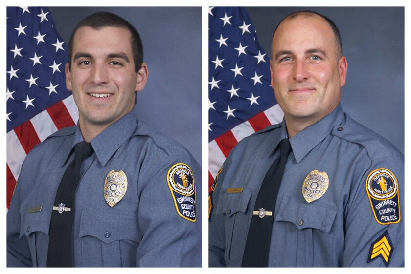 FILE - This combination of undated photos provided by the Gwinnett County Police Department shows Master Police Officer Robert McDonald, left, and Sgt. Michael Bongiovanni in their official portraits. A man who was punched and kicked in the head by the Georgia police officers during a traffic stop four years ago has filed a lawsuit. It alleges the stop was unjustified and the officers used excessive force against him. Bongiovanni and McDonald were fired a day after the April 2017 traffic stop when video surfaced. (Gwinnett County Police Department via AP)