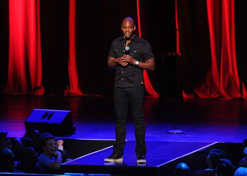 "Dave Chappelle performs at Radio City Music Hall in 2014. Chappelle is scheduled to host ""Saturday Night Live"" for the first time on Nov. 12."