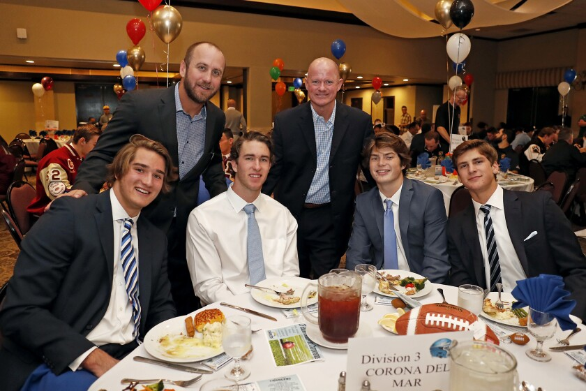 Corona del Mar tight end Mark Redman, left, offensive coordinator Kevin Hettig, receiver John Humphreys, coach Dan O'Shea, quarterback Ethan Garbers and linebacker Mason Gecowets attend the CIF Southern Section football championship luncheon on Monday at the Grand in Long Beach.