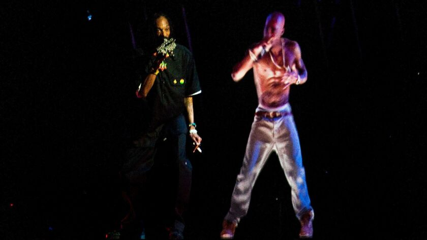 Snoop Dogg performs with a holographic image of Tupac during the Coachella Valley Music and Arts Fes