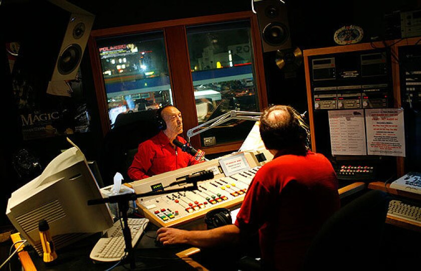 Radio legend Art Laboe, left, and producer Tom Peniston inside Laboe's Hollywood studio. His show ranks near the top in its evening time slot, according to Arbitron ratings, and is popular among listeners 25 to 54 years old.