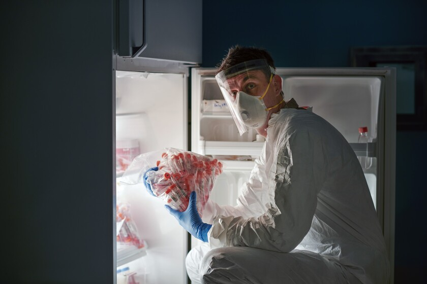 A researcher handles COVID-19 swabs prior to sequencing their viral DNA.