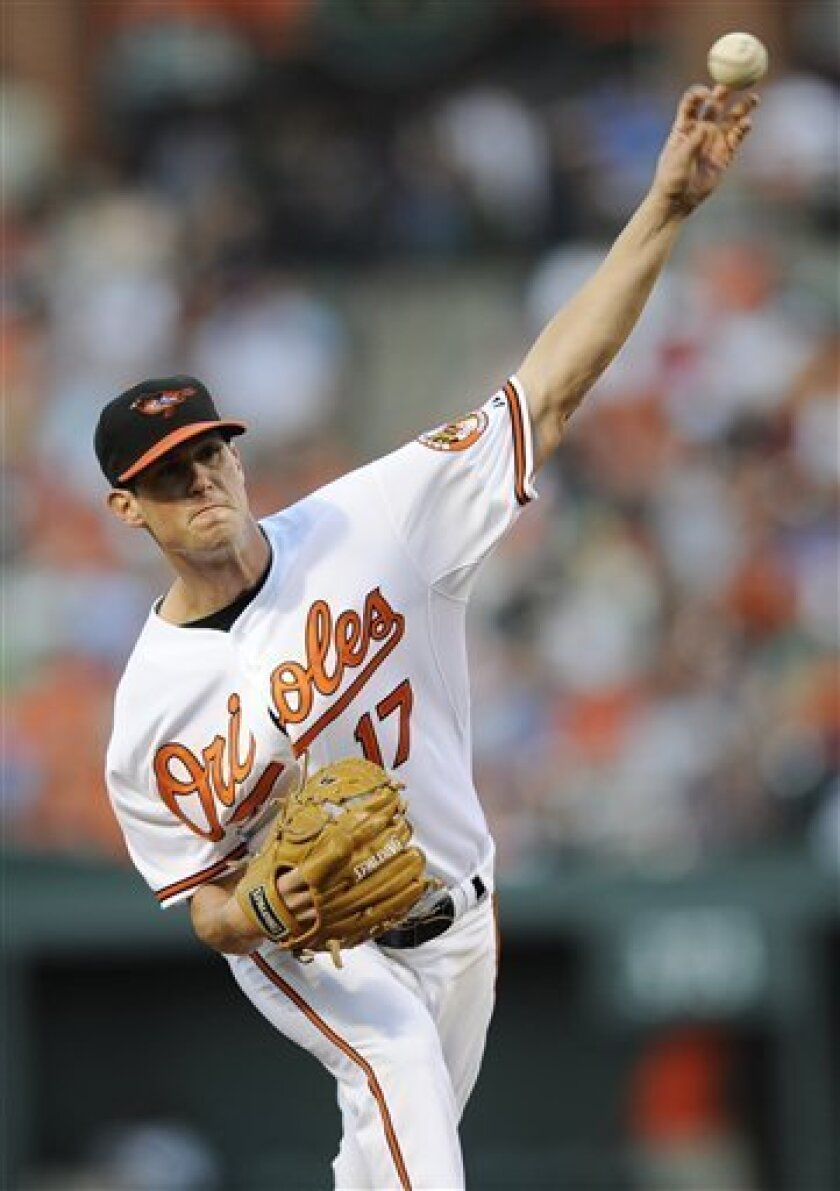 Baltimore Orioles starting pitcher Brian Matusz throws against the St. Louis Cardinals during the third inning of an interleague baseball game, Thursday, June 30, 2011, in Baltimore. (AP Photo/Nick Wass)