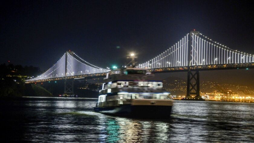 You can fly round trip to the City by the Bay for $90 on Southwest. The Bay Bridge and a ferry stand out at night.