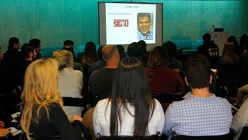 Students and members of Junior Seau's family listen to a talk by UC San Diego neurobiology professor Gentry Patrick on Wednesday.