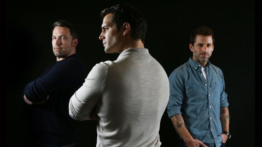 Actors Ben Affleck, left, Henry Cavill and director Zack Snyder.