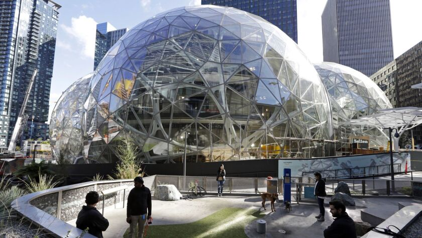In this photo taken Wednesday, Oct. 11, 2017, large spheres take shape in front of an existing Amazo