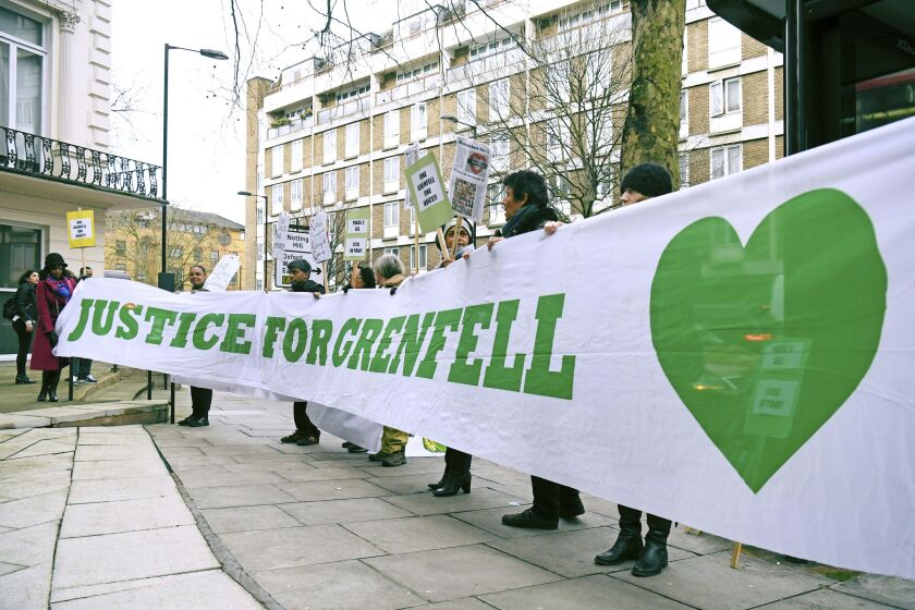 Protesters outside the Grenfell Tower public inquiry in London, Monday Jan. 27, 2020, where the second part of the inquiry into the Grenfell Tower fire, examining the circumstances and causes of the disaster, is due to start later. (Kirsty O' Connor/PA via AP)